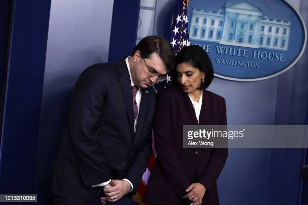 S Secretary of Veterans Affairs Robert Wilkie listens to Administrator of the Centers for Medicare and Medicaid Services Seema Verma prior to a news...