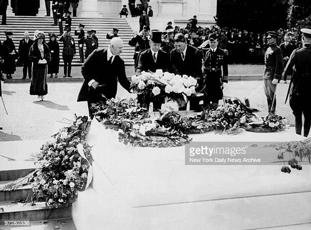 Secretary of War Weeks President Coolidge and Secretary of Navy Wilbur place wreath on Tomb of the Unknown Soldier in Arlington cemetery while Mrs...