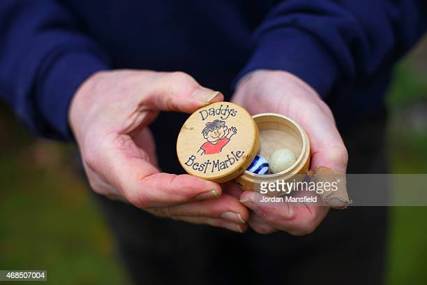 Secretary to the British Marble Board of Control Sam McCarthyFox shows off his 'tolleys' during the annual British and World Marbles Championships on...
