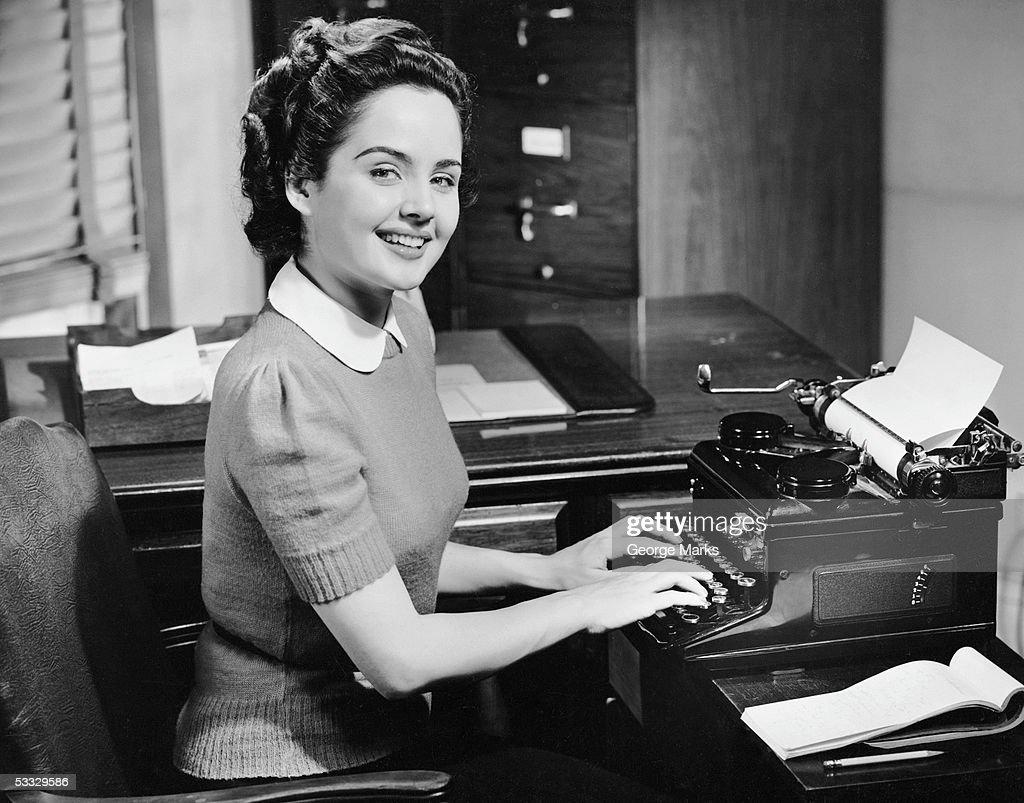 Secretary typing : Stock Photo