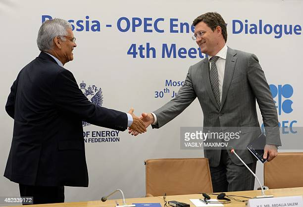 SecretaryGeneral Abdalla Salem ElBadri and Russia's Energy Minister Alexander Novak shake hands during a pressconference after RussiaOPEC energy...
