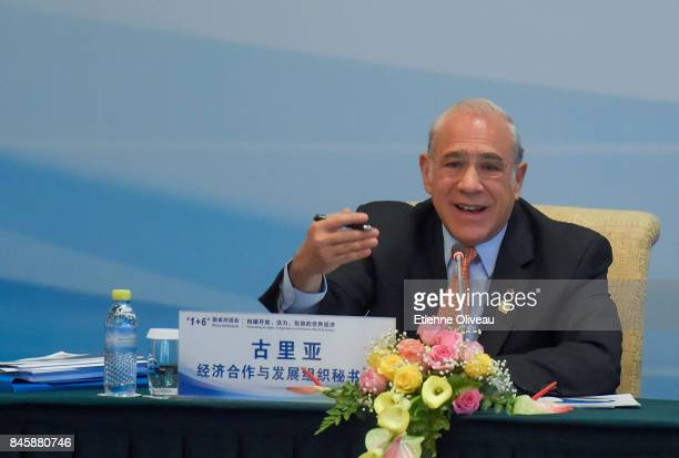 SecretaryGeneral Angel Gurra of the Organization for Economic Cooperation and Development speaks during The 16 Round Table Press Conference at...