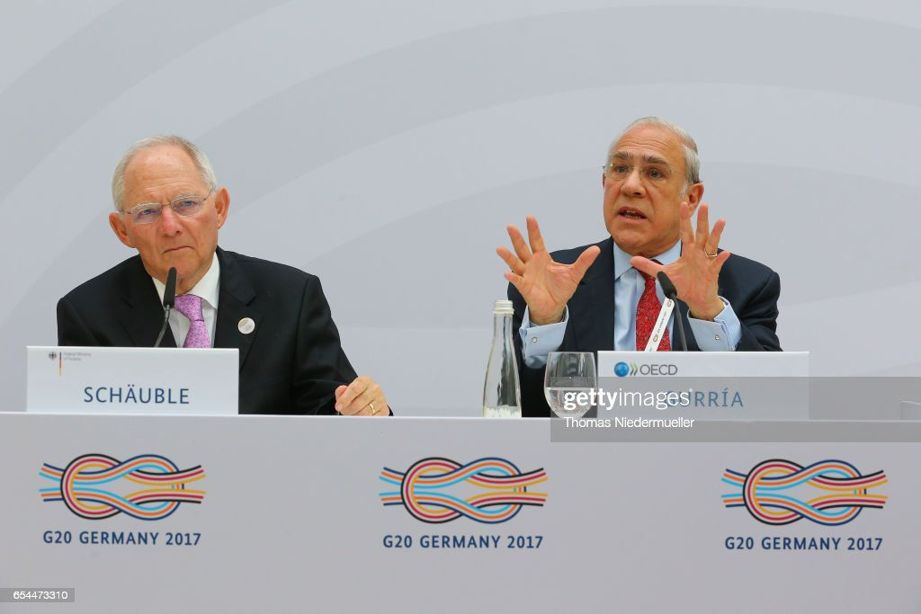 Secretary-General Angel Gurria (R) and Federal Minister of Finance Wolfgang Schaeuble (L) are seen during the 'Going for Growth' report presentation during the G20 finance minister's meeting on March 17, 2017 in Baden-Baden, Germany. The meeting is taking place ahead of the G20 summit scheduled in Hamburg in July.