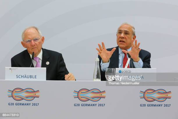 SecretaryGeneral Angel Gurria and Federal Minister of Finance Wolfgang Schaeuble are seen during the 'Going for Growth' report presentation during...
