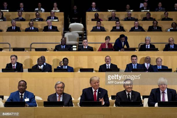 UN SecretaryGeneral Antonio Guterres and US President Donald Trump sit with other representatives before a meeting on United Nations Reform at the UN...