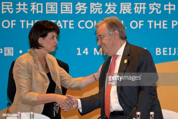 N SecretaryGeneral Antonio Guterres right chats with Switzerland President Doris Leuthard before a session on connectivity of development policies...