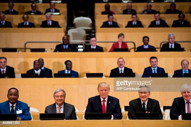 Secretary-General Antonio Guterres, US President Donald Trump and other participants wait for a meeting on United Nations Reform at the UN...