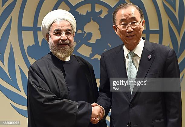 N SecretaryGeneral Ban Kimoon greets Iranian President Hassan Rouhani before a meeting at the United Nations on September 23 2014 in New York City...