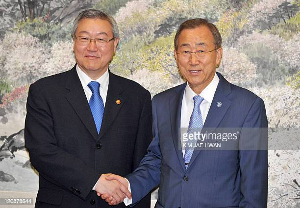 UN secretarygeneral Ban KiMoon shakes hand with South Korea's Foreign Minister Kim SungHwan during a meeting at Seoul on August 12 2011 Ban is on a...