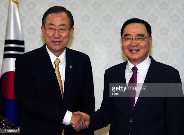 SecretaryGeneral Ban KiMoon shakes hands with South Korean Prime Minister Jung HongWon during their meeting at government complex on August 23 2013...