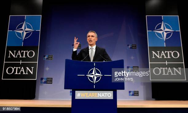 Secretary-General Jens Stoltenberg gestures as he delivers a speech during the second day of Defence Ministers Council meeting at the NATO...