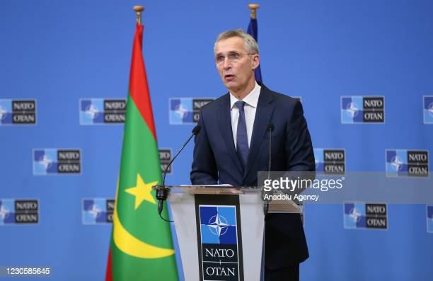 Secretary-General Jens Stoltenberg makes a speech as he holds a press briefing with Mauritanian President Mohamed Ould El-Ghzaouani after their...