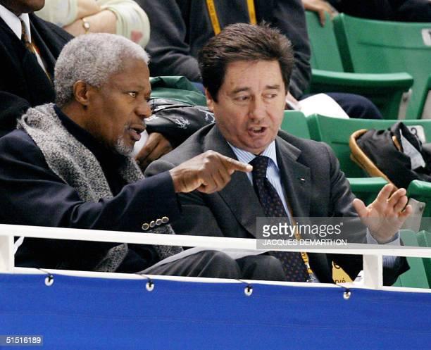 SecretaryGeneral Kofi Annan talks with International Skating Union president Ottavio Cinquanta during the pairs short figure skating program 09...