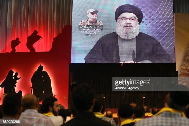 Secretary-General of Hezbollah Hassan Nasrallah live broadcasts during a commemoration event for Mustafa Badreddine, a soldier of Hezbollah killed in...