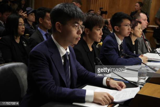 "Secretary-General of Hong Kong's Demosisto party and leader of the ""Umbrella Movement"" Joshua Wong, pro-democracy activist and Cantopop singer Denise..."