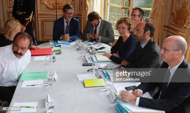 SecretaryGeneral of the General Confederation of Labour French worker's union Philippe Martinez is watched by French Prime Minister Edouard Philippe...