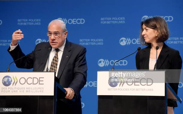 SecretaryGeneral of the Organisation for Economic Cooperation and Development Jose Angel Gurria and New Chief Economist of the Organisation for...