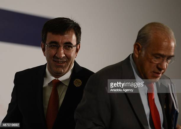 SecretaryGeneral of the Organisation for Economic Cooperation and Development Angel Gurria and Turkey's Deputy Prime Minister Cevdet Yilmaz are seen...
