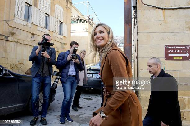 UN SecretaryGeneral's Special Advocate for Inclusive Finance for Development Queen Maxima of the Netherlands walks in Salt some 30 kilometers north...