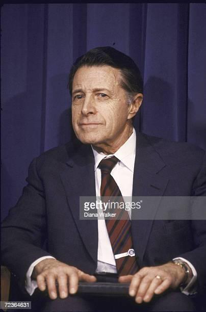 Secretaryof Def Cap Weinberger listening during budget briefing by President Reagan