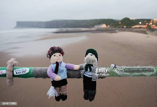 A secretive group of knitters known as the Saltburn Yarn Stormers have left a display of knitting celebrating Yorkshire attached to railings on the...