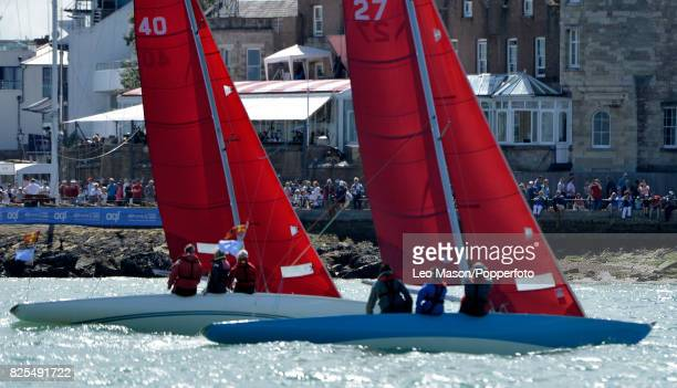 Sectators watch teams compete in preliminary heats during Aberdeen Asset Management Cowes Week on August 1 2017 in Cowes England
