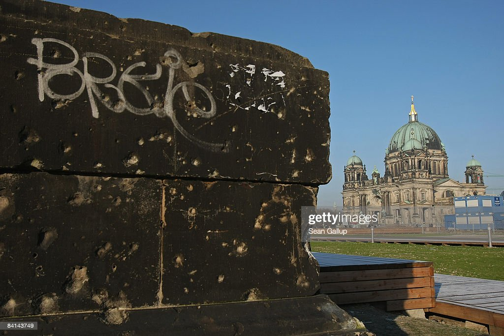 A section of a wall still pockmarked with bullet holes from World War II stands at Schlossplatz near the Berliner Dom cathedral on December 30, 2008 in Berlin, Germany. City officials recently announced that they have the green light to begin construction of the new Stadtschloss, or Berlin City Palace, at the site. According to a recently-released report Berlin is Europe's third most popular tourism destination after London and Paris.
