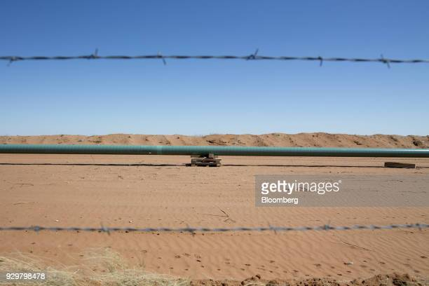 A section of an oil pipeline sits on blocking during construction in the Permian Basin near Pyote Texas US on Friday March 2 2018 Chevron the world's...