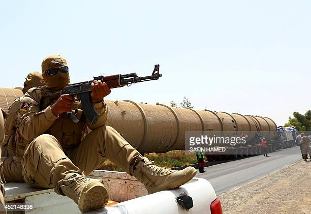 A section of an oil refinery is guarded as it is brought on a lorry to the Kawergosk Refinery some 20 kilometres east of Arbil the capital of the...