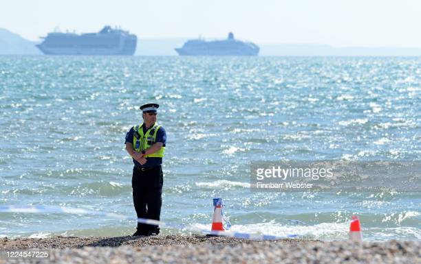 A section of beach has been closed whilst police await the bomb squad after a suspicious item was found on May 13 2020 in Weymouth United Kingdom The...