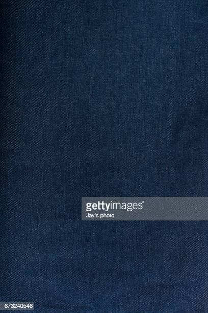 a section of blue denim jeans - denim stock pictures, royalty-free photos & images