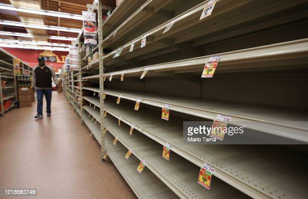 A section of empty shelves is seen during special shopping hours only open to seniors and the disabled at Northgate Gonzalez Market a Hispanic...