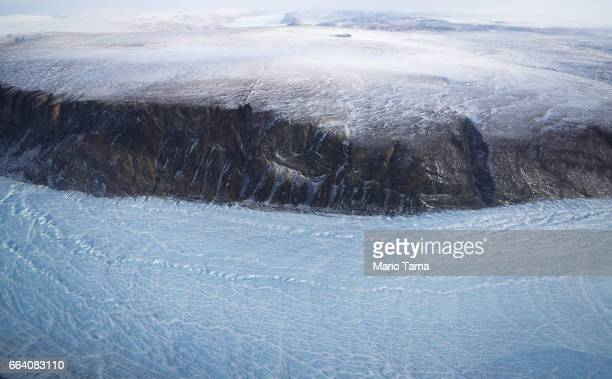 A section of glacier is seen from NASA's Operation IceBridge research aircraft along the Upper Baffin Bay coast on March 27 2017 above Greenland...