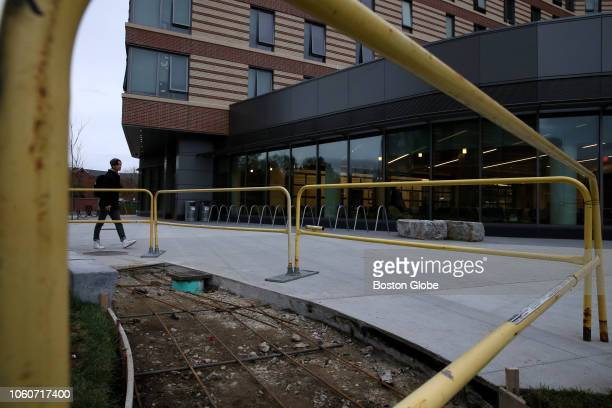 A section of sidewalk outside the new dorms at UMass Boston is pictured on Nov 9 2018 The freshmen who moved into UMass Bostons firstever dormitory...