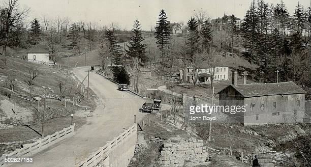 Section of suburbs of Waterdown Ont showing view of highway to Burlington and bridge over Waterdown creek and old mill River here drops into deep...