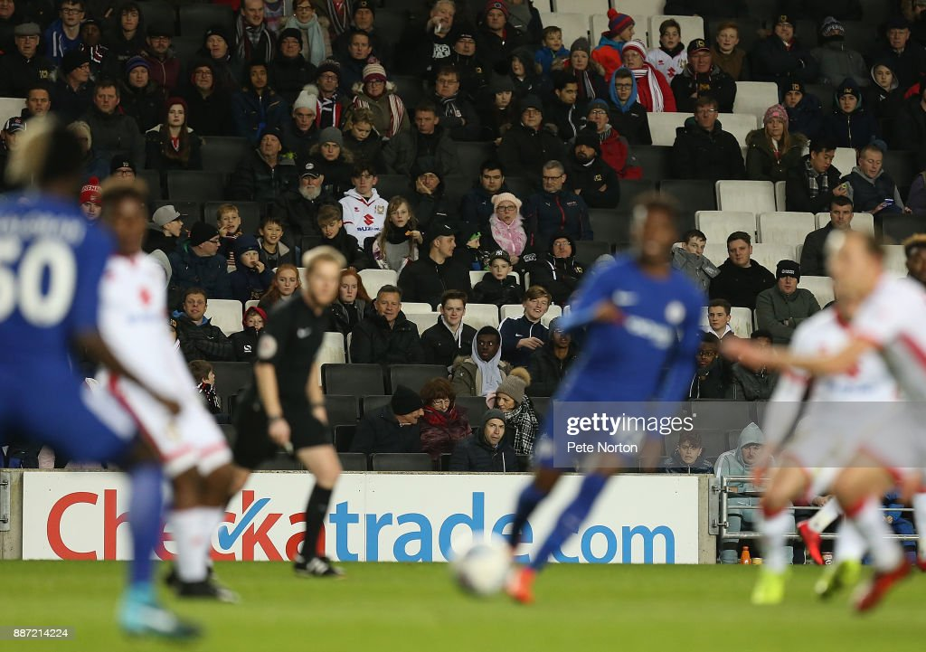 A section of the 1549 fans who attended the game look on during the Checkatrade Trophy Second Round match between Milton Keynes Dons and Chelsea U21vat StadiumMK on December 6, 2017 in Milton Keynes, England.