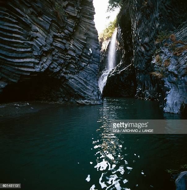 A section of the Alcantara river between stratified and prismatic basalt walls Alcantara Gorge Sicily Italy
