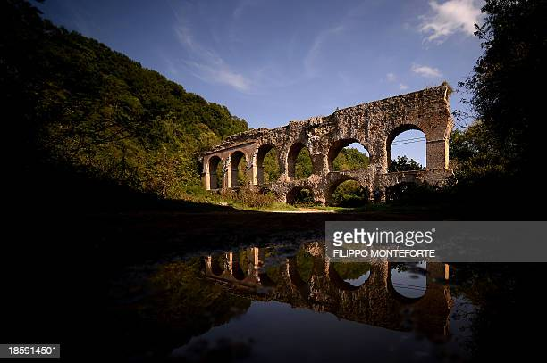 THUBURN A section of the Anio Vetus aqueduct stands in the countryside near Tivoli 30 km out of Rome on September 28 2013 A group of speleologists is...