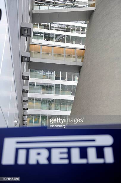 A section of the cooling tower of the old Pirelli factory part of the new Pirelli C SpA headquarters is seen behind the company's logo in Milan Italy...