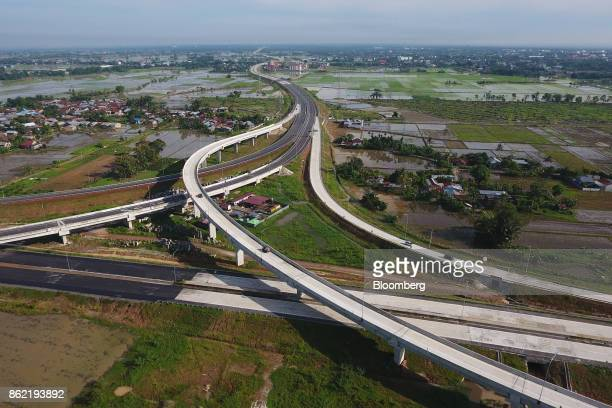 A section of the MedanKualanamuTebing Tinggi toll road is seen alongside farm land in this aerial photograph taken in Medan North Sumatra Indonesia...