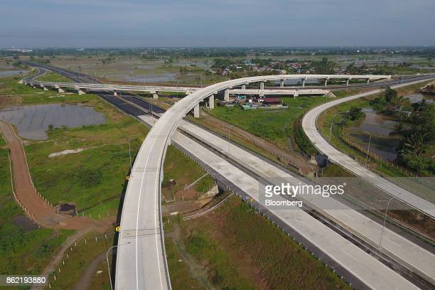 A section of the MedanKualanamuTebing Tinggi toll road is seen in this aerial photograph taken in Medan North Sumatra Indonesia on Friday Oct 13 2017...