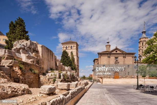 a section of the old roman wall, torreon de la zuda, the church of san juan de los panetes and the leaning tower of zaragoza, the torre nueva, zaragoza, aragon, spain - old san juan wall stock photos and pictures