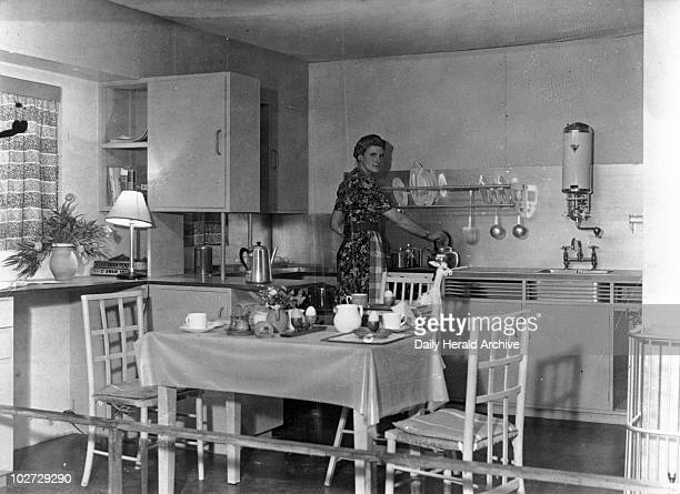 A section of the specially designed gas kitchen London 1946 A section of the specially designed gas kitchen which allows the mother of a young family...