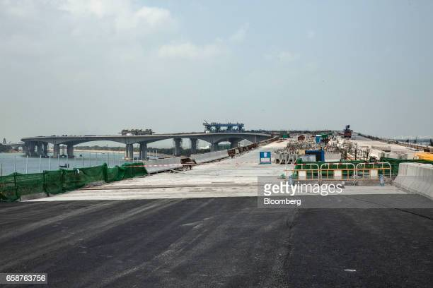 A section of the the Hong KongZhuhaiMacau Bridge stands under construction in Hong Kong China on Tuesday March 28 2017 Hong Kongs next chief...