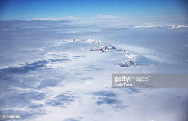 A section of the West Antarctic Ice Sheet with mountains is viewed from a window of a NASA Operation IceBridge airplane on October 31 2016 inflight...