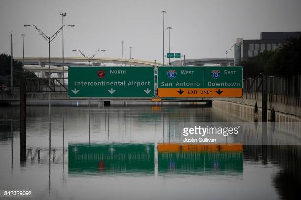 A section of US90 sits under 16 feet of water on September 3 2017 in Houston Texas A week after Hurricane Harvey hit Southern Texas residents are...