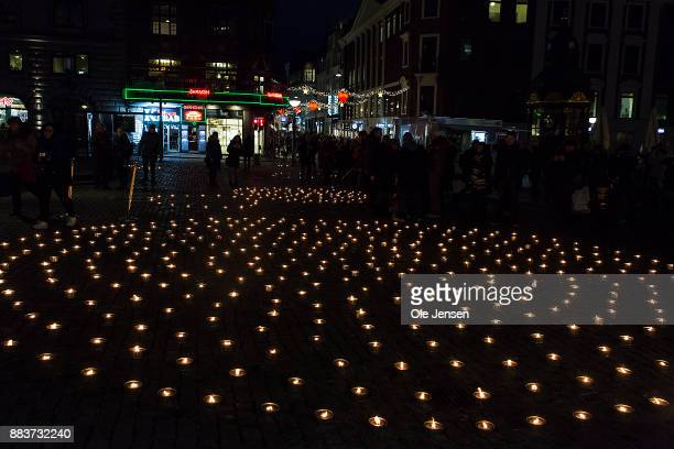 A section with the many circles of candle lights in remembrance of World AIDS Day and where Princess Marie and children lighted a candle at Gammel...