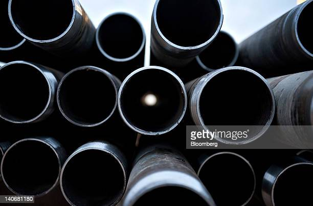 Sections of drill pipe sit on a rack as Unit Drilling Co crude oil rig 123 drills a crude oil well outside Watford City North Dakota US on Tuesday...