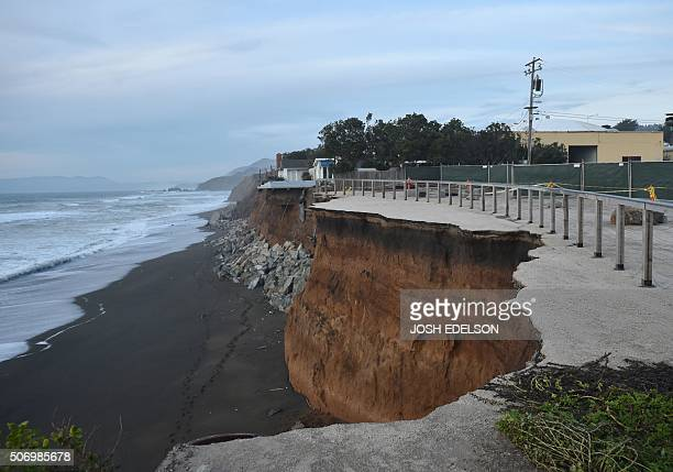 Sections of land are seen missing after falling to the sea in Pacifica California on January 26 as storms and powerful waves caused by El Nino have...