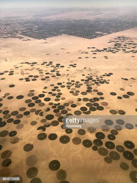 Sections of land used for center pivot irrigation sit in this aerial photograph taken near the AlJawf region Saudi Arabia on Tuesday April 4 2017UK...
